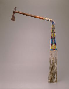 Pipe-tomahawk, c. 1870  Crow  Wood, iron, copper, glass beads, sinew