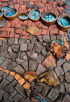 love the idea of the copper pipes filled with mosaic.    mosaic art now; sept 19th 2011