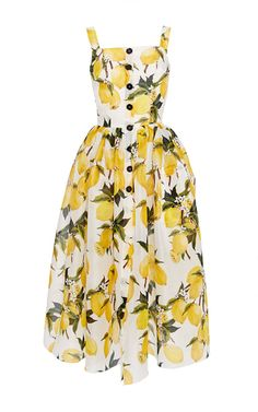 A celebration of Italy as seen through the eyes of tourists in post-World War II Italy was the theme for Stefano Gabbana and Domenico Dolce's Spring 2015 collection. This **Dolce & Gabbana** dress features a bright lemon print and richly textured needlepoint embellishment.