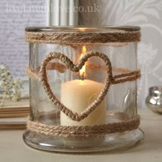 1001 Ideas for Summer DIYs to Brighten Up Your Home summer crafts big jar decorated with burlap ropes with heart-shape detail containing one lit candle The post 1001 Ideas for Summer DIYs to Brighten Up Your Home appeared first on Summer Diy. Pot Mason Diy, Mason Jar Crafts, Bottle Crafts, Mason Jars, Bottles And Jars, Glass Jars, Diy Candles, Candle Jars, Homemade Candles