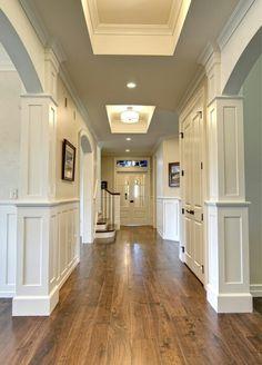 Hallway - the black door fixtures on the white panel doors are so classy
