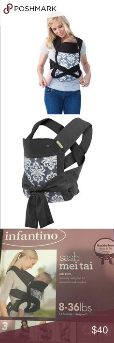 Infantino sash mei tai carrier New baby infantino sash mei tai carrier! Holds baby from 8-36lbs. Designed for babies and toddlers . Buckle free wrap and tie design. Naturally designed for custom fit and comfort . Has 3 carrying positions and comes in black and white damask with grey background Infantino Bags Backpacks