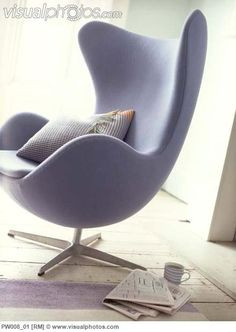 purple_upholstered_arne_jacobsen_swan_chair_with_cushion_and_mug_of_tea_and_newspaper_PW008_01.jpg (440×620)
