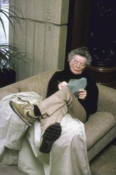 Katharine Hepburn on couch, writing on papers in lap for book about making the movie, The African Queen (1951) in 1987.