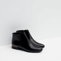 Image 7 of FLAT ANKLE BOOTS WITH METAL DETAIL from Zara