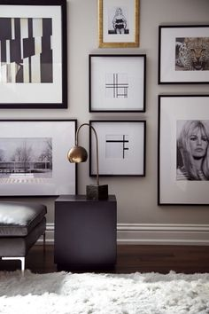 hello sukio || luxe interiors, combination of framed artwork and photography, white wall, wooden floors, white fluffy carpet, modern light