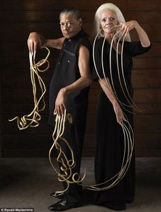 Lee Redmond, right, pictured just months before her car crash, along with Melvin Booth, the male owner of the world's longest fingernails at 29ft 8in