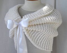 Scarf with sleeves at both ends in dark gray. FREE WORLDWIDE