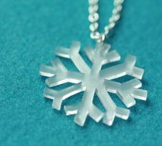 Shrinky Dink Snowflake Necklace | AllFreeHolidayCrafts.com Plastic Spoons, Shrink Art, Kids Necklace, Crafts For Kids To Make, Shrinky Dinks, Cute Gifts, Eyelashes, Jewelry Crafts, Festive