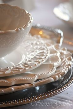 I ♥ these dishes & have several set(s) similar to these!!! they are stoneware & go great with anything! You can dress them up or dress them down...you cannot go wrong with these as accent pieces & adore how the ivory shade goes with anything...can't tell I love this can you!?! kj