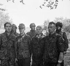 Waffen-SS snipers captured by Allied troops near Arnhem, Gelderland, the Netherlands, 18 Sep 1944