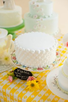 I really love the large dot iced pattern on this cake. Very sweet.