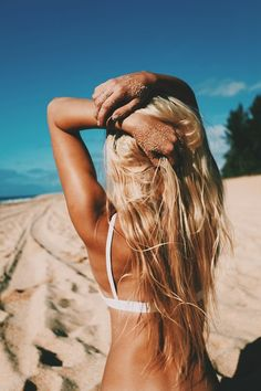 Blonde, wavy beach hair. I wish I could get that tan!!