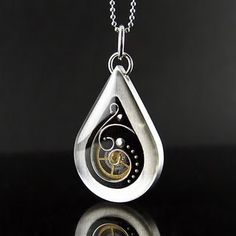 "Reversible Necklace, small tear drop, Art Deco steam punk.     Pendant Measures: 1 1/8"" tall x 3/4"" wide, total length with bail is 1 3/8"""