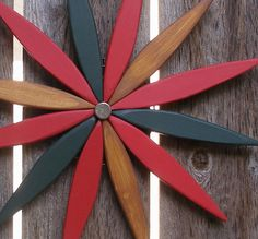 For your outdoor and indoor holiday and Christmas decorating this year I've created a colorful wooden folk art style starburst wooden wreath