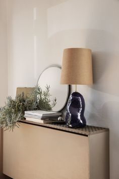 Hebe Lamp - Medium by ferm LIVING BaseColor: Dark BlueSize: W: x H: x D: 14 cmMaterial: Ceramic base with brass rod for socket 2 metre twisted fabric cord with dimmerShadeColor: CurrySize: Ø: x H: cmMaterial: Fabric covered lampshade with metal structure Cover Lampshade, Design Bestseller, Nordic Home, Metal Structure, Home Decor Store, Lamp Bases, Textiles, Interior Design, Nordic Interior