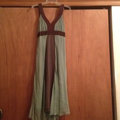 Beautiful sage green and brown dress. Never worn! This ethereal silk dress in sage green has never been worn. (I did remove the tags after purchasing and it has sat in my closet since then desperately waiting to be worn.) There is lovely tiny stud detailing around the deep V neckline as you can see in picture 2. It has a simple sash that ties in the back. Jonathan martin Dresses