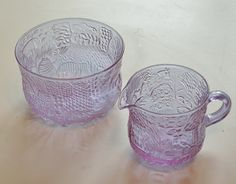 Creamer jug and small bowl in Fauna pattern. In a thin molded lilac (Alexandrite) glass. Designed by Oiva Toikka for Nuutajarvi Notsjo, Finland.