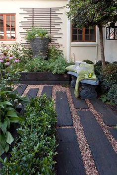 Jo Clinton Design's courtyard garden for private clients in Parkhurst, Johanesburg using a pathway of railway sleepers of various lengths and gravel