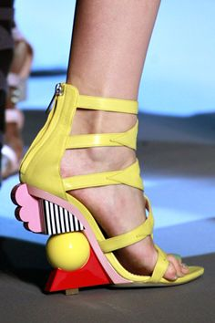 Dior: Yellow geometric high healed shoes with abstract blocks in stripes pink and orange as the heals. #uniqueshoes #yellow #yellowshoes