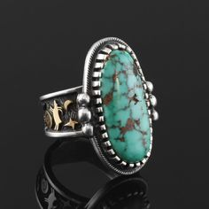 Arland Ben is a favorite among collectors. Shown here is a Natural Godber Turquoise Ring with Sterling Silver and 14K Gold.   Native American | Indian | Jewelry | Rings | Hand Made
