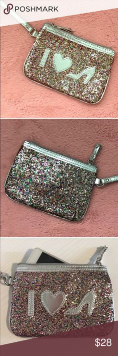 🚨LAST CHANCE🚨NORDSTROM LOVE SHOES WRISTLET NWOT 💗Condition: New without tags, No flaws. Silver and sparkles. Fits an Iphone 6- inside. 💗Smoke free home 💗No trades, No returns 💗No modeling  💗Shipping next day 💗I LOVE OFFERS, offer me! 💗BUNDLE and save more 💗All transactions video recorded to ensure quality.  💗Ask all questions before buying Nordstrom Bags Clutches & Wristlets