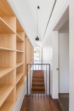 Timber shelving and minimalist details keep the interior of House Chapple minimal and light