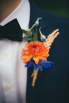 Bright coral / purple buttonhole - Lucy G Photography - A marquee wedding with a lace gown and colour pop theme with mix and match centrepieces.