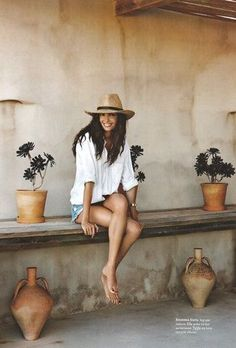 cut off jean shorts, white button down, and a sun hat. cute and casual summer style.
