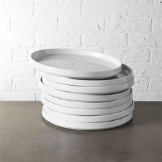 Shop set of 8 frank dinner plates. Take a lesson from the bauhaus school of design, circa 1920s Berlin. Simplicity and utility in white stacking porcelain. Dishwasher-, microwave- and oven-safe.