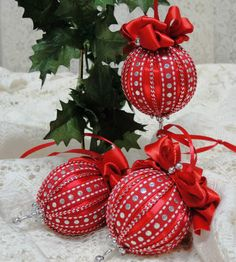 """Set of 3 small 3"""" vintage satin balls. Decorated with ribbons and bows."""