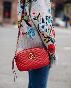 Add an instant recognisable beauty to your bag edit this season with Gucci's Marmont leather crossbody bag.