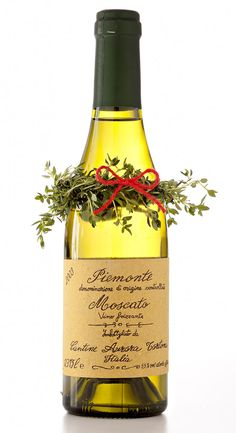 Holidays: A mini wreath dresses up a wine bottle to give as a hostess gift.
