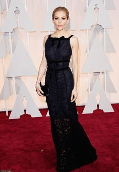 Wow: Sienna Miller looked sensational in fitted navy Oscar de la Renta gown with featured lace detail and a semi-sheer skirt