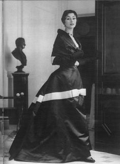 Books and Art: Anne Gunning with sculpture in Dior's black satin...