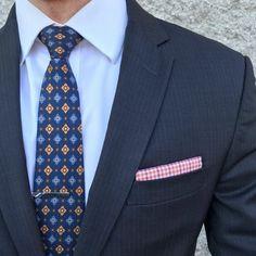 Suited up in a vintage print tie.