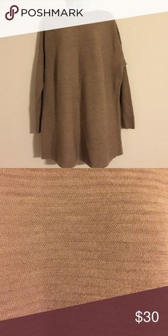 Tahari wool sweater taupe color size 1 X Gently worn and dry cleaned Tahari slip over  style taupe color 100% fine woven wool. Beautiful Tahari Sweaters Crew & Scoop Necks