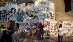 Women on Walls, founder of GrEEK Campus Ahmed El-Alfy steps in to remove graffiti insulting Mia Grondahl on Youssef El-Guindy street. April 2015. (Photo: David Cordova)