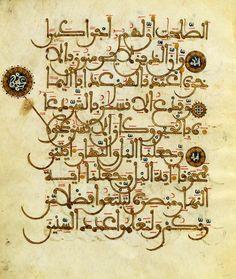 Or, noir, bleu et jaune dans une page d'écriture maghrébine  Partie de coran  Maghreb, XIIIe-XIVe siècles.
