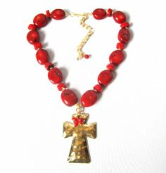 Red coral oval beads with a hammered, gold plated cross necklace