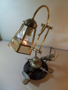 Super cool upcycled and repurposed lamp made of salvaged materials...