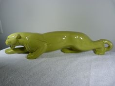 A Panther  tv lamp in chartreuse...... just like this! @ the Green Apple.....also have one in rose red.