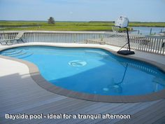 After a day on the water relax by the pool on the large pool deck, the ideal place for afternoon sunning or the family barbecue.  Ferguson Dechert Real Estate Avalon, NJ