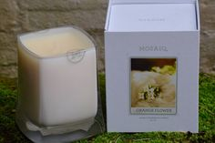 MOSAIQ CANDLE - ORANGE FLOWER 14OZ  The essence of spring is difficult to describe, but certainly felt by all. As cold days give way to the suns warming light, a tangible excitement can be felt. This splendid fragrance combines sweet orange blossoms still dusted with pollen and the green leaves of the tree, evoking a scent that is both fresh and new. FRAGRANCE NOTES | Orange blossom, tangerine, clementine leaves, water lily.