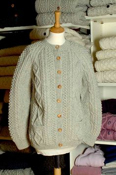 Made from 100% pure wool, this traditional Irish Fisherman style cardigan, has been specially handknitted for us in South West Donegal.   Our knitters draw on a lifetime of experience using ancient patterns and skills passed down from generation to generation.
