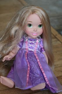 In a travel size spray bottle, use 2 tbs fabric softener and the rest water.  Use as a detangler for dolls hair.