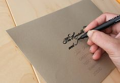 DIY Faux Calligraphy: print names & addresses in a light colored grey on envelopes, invites, etc. Then, trace over them with a calligraphy pen. The beauty & charm of hand-drawn calligraphy for those without the skill!!
