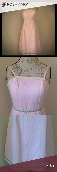 Lilly Pulitzer dress Shell 100% cotton Lining 65% polyester 35% cotton. Sweet pink summer dress, adjustable spaghetti straps with green ribbon detail on top hem, waist and bottom hem. Boning at sides, back zip with hook & eye closure Lilly Pulitzer Dresses