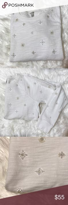 J. Crew white beaded sweatshirt perfect 4 holidays Beautiful white pullover with bead and sequin detailing throughout! In great condition! Just had a few spots towards bottom and one at the back of the neck as shown. Light pilling. Perfect for the holidays! J. Crew Sweaters Crew & Scoop Necks