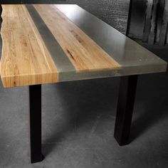 "#ARTmetal © ideas. www.aias.se Concrete Wood & Steel Dining Kitchen TableHandcrafted from concrete, wood and steel, this dining room table measuring 90"" in length x 42"" wide x 30"" tall was created using natural grey concrete contrasted with a center wo…"
